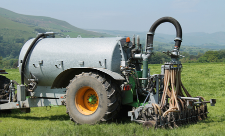 An Agricultural Farm Slurry Tanker with Shallow Injector. Stock Photo