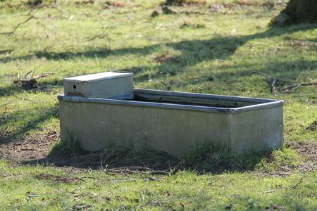 galvanised: A Galvanised Metal Animal Water Trough in a Farm Field.