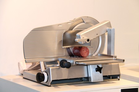 cutter: Catering Equipment for Producing Slices of Cooked Meat.