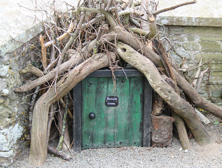 feature: A Novelty Beavers Lodge Doorway as a Garden Feature. Stock Photo