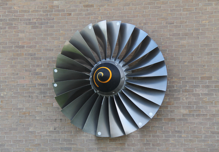propulsion: The Blades from a Jet Engine Displayed on a Brick Wall.
