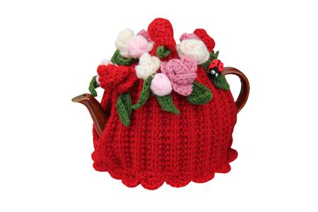 A Woollen Knitted Tea Cosy on a Teapot.