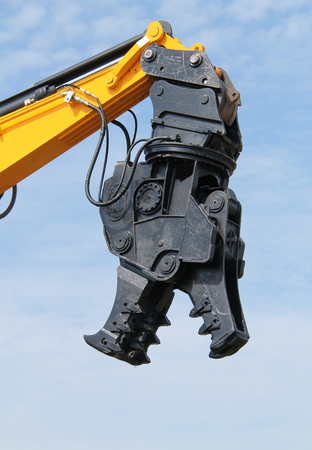 A Hydraulic Rotating Pulveriser Attachment for Demolition.