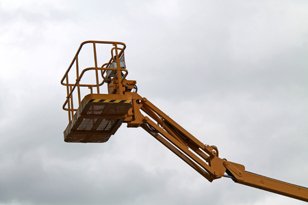 The Cage and Arm of an Hydraulic Lift Cherry Picker. Stock Photo