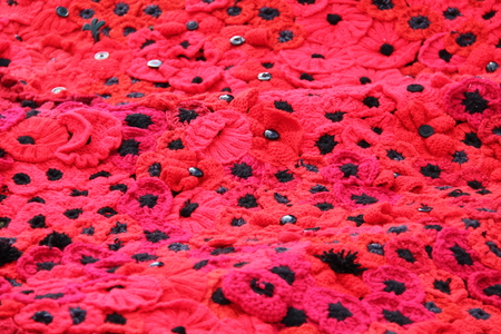 A Blanket of Knitted Red Remembrance Poppies. Фото со стока