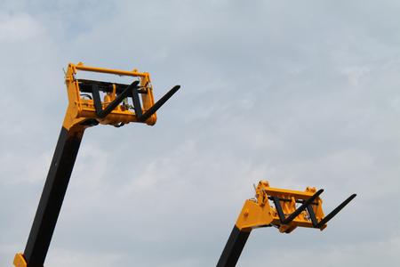A Pair of Industrial Long Reach Fork Lift Trucks.