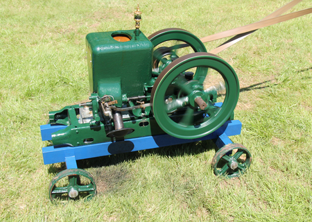 A Classic Vintage Pump with Flywheel and Drive Belt. Stock Photo