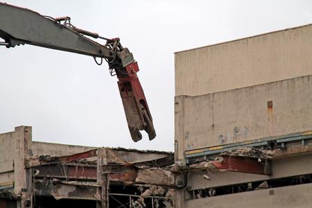 A Pulveriser Crane Working on a Building Demolition.