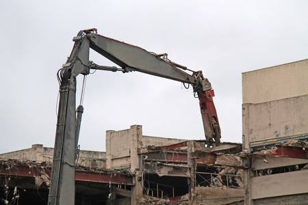A Pulveriser Machine Pulling Out a Building Steel Girder.