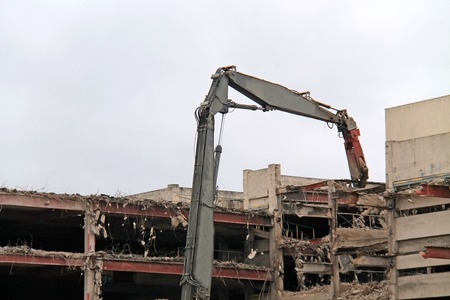 The Dismantling of a Building with a Pulveriser Excavator.