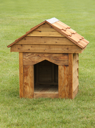 A Traditional Overlap Outdoor Wooden Dog Kennel.