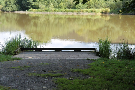 A Wooden Fishing Stage on a Tranquil Lakeside.