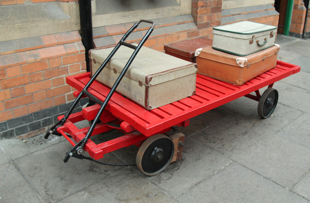 A Vintage Luggage Trolley on a Railway Station Platform.