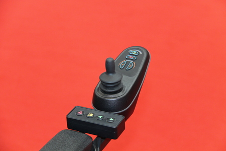 Joystick and Buttons of an Electric Mobility Chair. Stock Photo