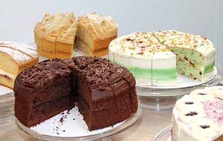A Selection of Freshly Baked and Sliced Dessert Cakes.