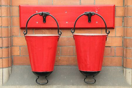 Two Red Vintage Metal Fire Sand Buckets.
