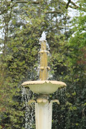 An Ornamental Metal Water Fountain in a Formal Garden. 스톡 콘텐츠