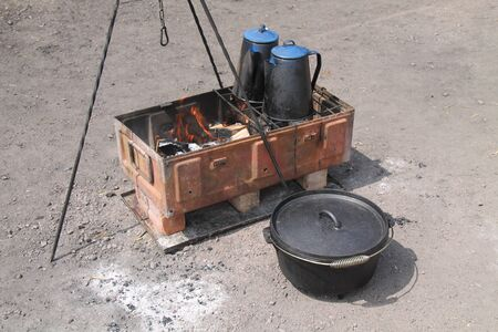A Basic Outdoor Wood Stove Made from a Metal Box.