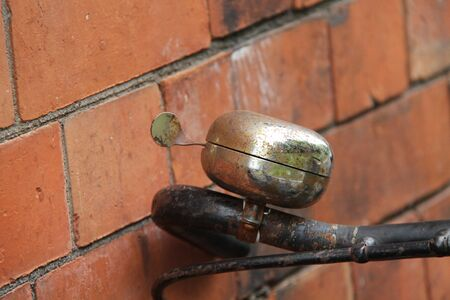 The Rusty Warning Bell on a Vintage Pedal Bicycle. Stockfoto