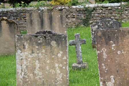 Ancient Headstones in a Church Cemetery Graveyard. Stock Photo - 130229362