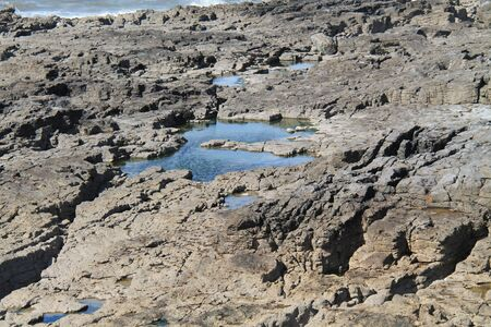 A Collection of Coastal Salt Water Tidal Rock Pools. Stock Photo