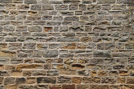The Weathered Wall of a Vintage Stone Built Building.