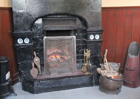A Vintage Open Coal Fired Fireplace and Tools.