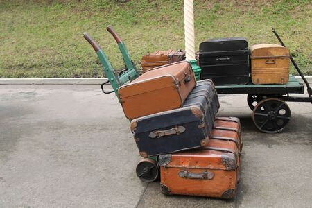 Two Railway Station Luggage Trollies with Cases. Stock Photo