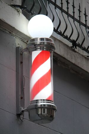 A Traditional Red and White Mens Barber Shop Sign. Zdjęcie Seryjne