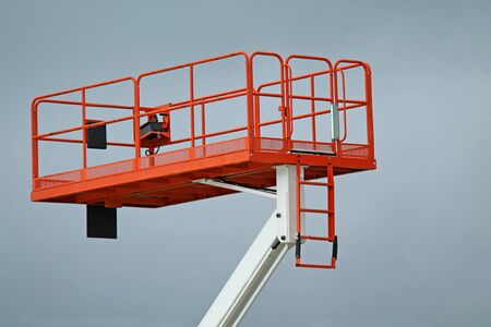 A Large Cage on an Hydraulic Cherry Picker Lift.