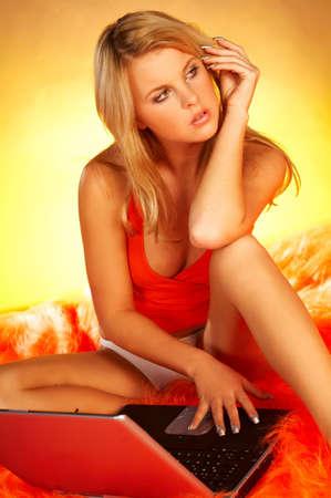 Sexy blonde using laptop computer photo