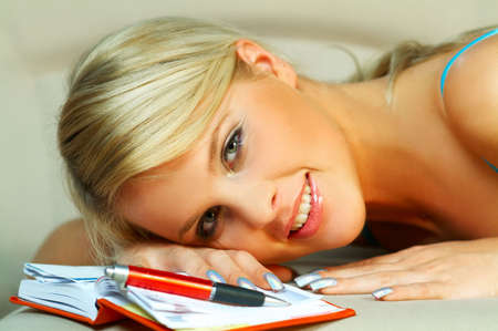 Blonde woman with datebook Stock Photo
