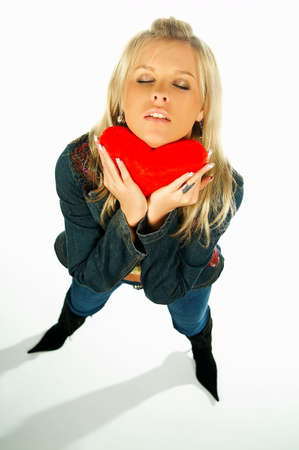 Blonde sexy girl holding a red velvet heart photo