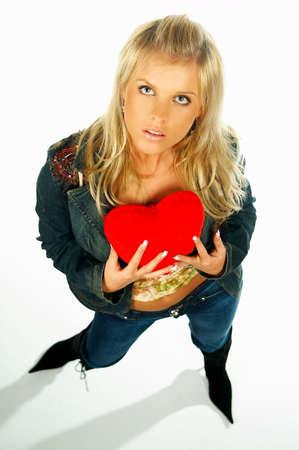 Blonde sexy girl holding a red velvet heart photo