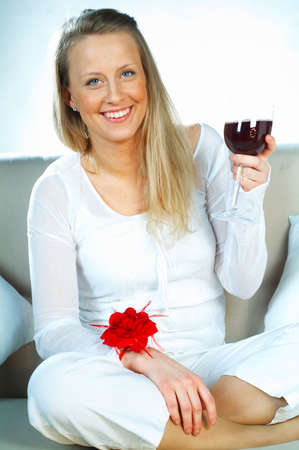 drinkable: Pretty young blonde women with glass of red wine