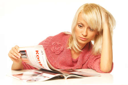 codex: Young pretty women reading a color magazine. Stock Photo