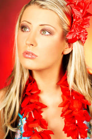 Sexy blonde girl with red hawaii flowers photo