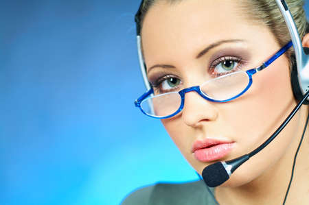 Beautiful young woman working as Call Center operator