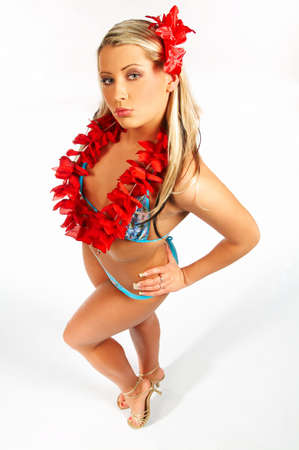 Sexy blonde girl in bikini with red hawaii flowers on white background photo