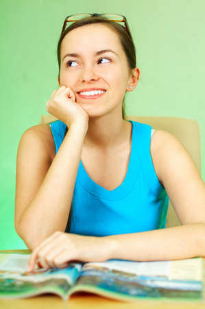 Young pretty women reading a color magazine