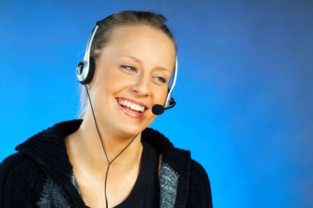 Young pretty woman wearing a phone headset. Call Centre Agent photo