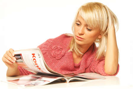 compendium: Young pretty women reading a color magazine. Stock Photo