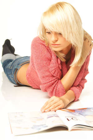 dissertation: Young pretty women reading a color magazine. Stock Photo