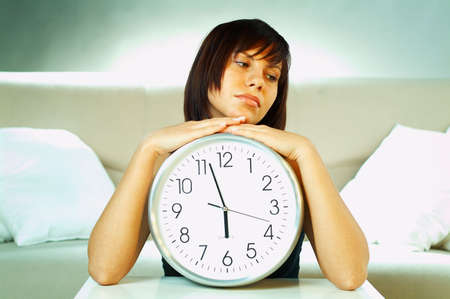Brunette young woman with classic clock photo