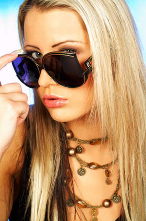 Portrait of attractive beautiful young woman wearing sunglasses photo