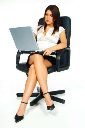 Sexy Business women using laptop computer sitting on office chair Stock Photo