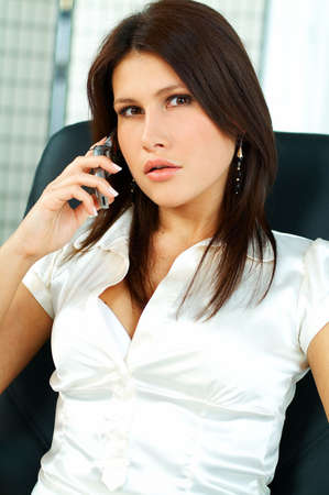 sexy breasts: Sexy Business women talking cell phone sitting on office chair