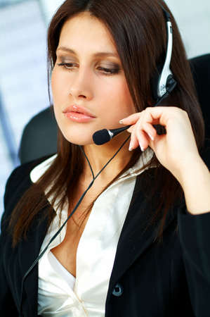 telephone saleswoman: Beautiful young woman working as Call Center operator
