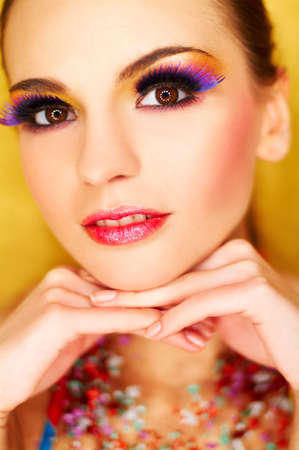 Portrait of attractive beautiful young sexy woman with artificial eyelashes and beautiful makeup photo