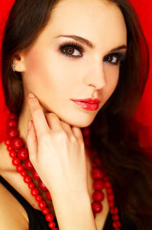Portrait of attractive beautiful young sexy woman with black artificial eyelashes and red necklace Stock Photo - 375664